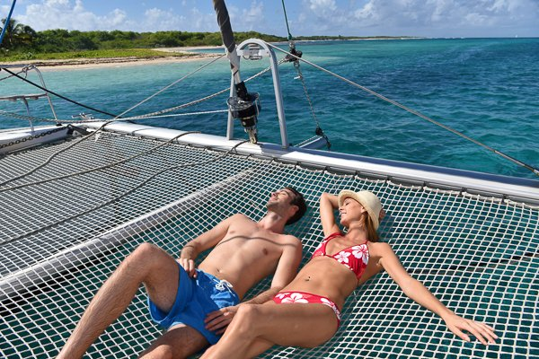 couple relaxing on a catamaran